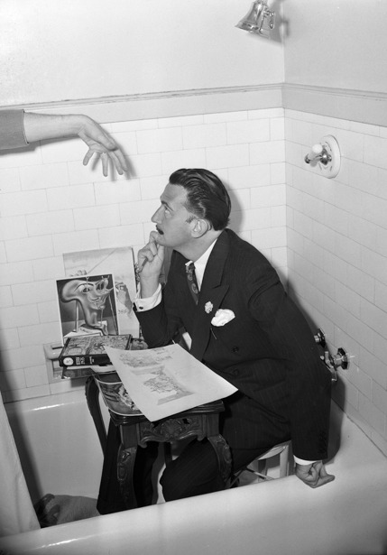 "my1930s:  Salvador Dali in a bathtub June 19, 1944: Surrealist Salvador Dali poses in his small temporary workplace, a bathtub in the Ambassador Hotel. The Times wrote in a front-page story:  He likes to work in small, cramped places. ""Protection,"" he says, fondly patting a close wall. Yesterday it was the bathtub. But don't get the idea that the fellow is washed up.  The artist was in California during preparation for a production of the ballet ""Mad Tristan,"" for which he was designing the set and costumes. The ballet premiered in New York later that year. Source: Los Angeles Times"