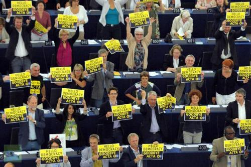 danideerambles:  The European Parliament voted very much against ACTA today. The picture shows members of the parliament holding up signs with the message 'hello democracy, goodbye ACTA'. Picture by Frederick Florin/AFP.