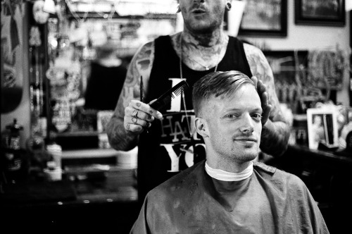 Astronautalis getting his hair did Proper. Shot on Tri-x, pushed +1
