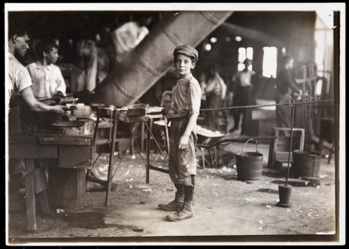A carrying-in-boy in a Virginia glass factory.  He works all night every other week. by Jacob A. Riis 1911