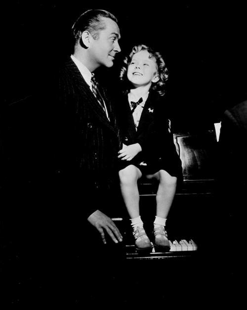 James Dunn and Shirley Temple behind the scenes of Stand Up and Cheer, 1934.