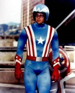 "Happy 4th of July from CAPTAIN AMERICA! As played by SPACE MUTINY'S Reb ""David 'Slab Bulkhead-Fridge LargeMeat-Punt Speedchunk-Butch Deadlift-Bold BigFlank-Splint Chesthair-Flint Ironstag-Bolt VanderHuge-Thick McRunfast-Blast Hardcheese-Buff Drinklots-Crunch Slamchest-Fist Rockbone-Stump Beefknob-Smash Lampjaw-Punch Rockgroin-Buck Plankchest-Stump Junkman-Dirk Hardpec-Rip Steakface-Slate Slabrock-Crud Bonemeal-Brick Hardmeat-Rip Slagcheek-Punch Sideiron-Gristle McThornbody-Slate Fistcrunch-Buff Hardpack-Bob Johnson-Blast Thickneck-Crunch Buttsteak-Slab Squatthrust-Lump Beefbroth-Touch Rustrod-Beef Blastbody-Big McLargehuge-Smoke Manmuscle-Beat Punchmeat-Hack Blowfist-Roll Fizzlebeef' Ryder"" Brown. (And yes, this Cap needs a dance belt.)"