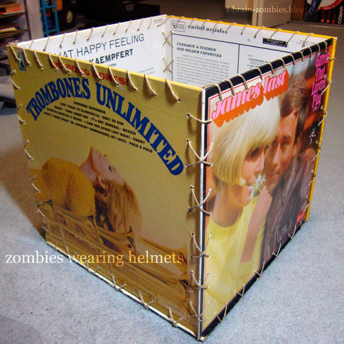 DIY Vinyl Record Storage Box Tutorial from Zombies Wearing Helmets here. First seen at decor hacks here. *What do you do with old records and record covers? See some posts here: truebluemeandyou.tumblr.com/tagged/record