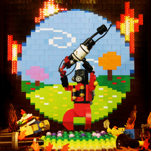 "otlgaming:  DO YOU BELIEVE IN MAGIC? Meet the LEGO Pyro with Matt De Lanoy's LEGO mosaic version of Pyrovision inspired by Valve's Team Fortress 2 ""Meet the Pyro"" video. (via The Brothers Brick) Meet your links:  Balloonicorn 