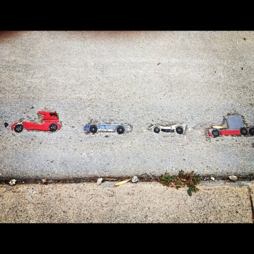 journhi:  Little toy cars in the pavement :) (Taken with Instagram)   Capture the present; before you know it, it'll be the past.
