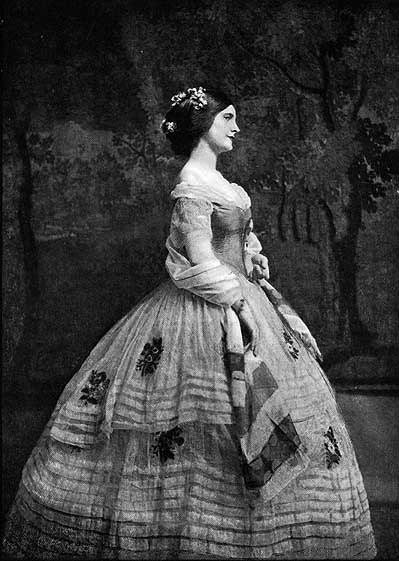historiful:  An unidentified woman modeling a mid-nineteenth century ensemble, 1913.