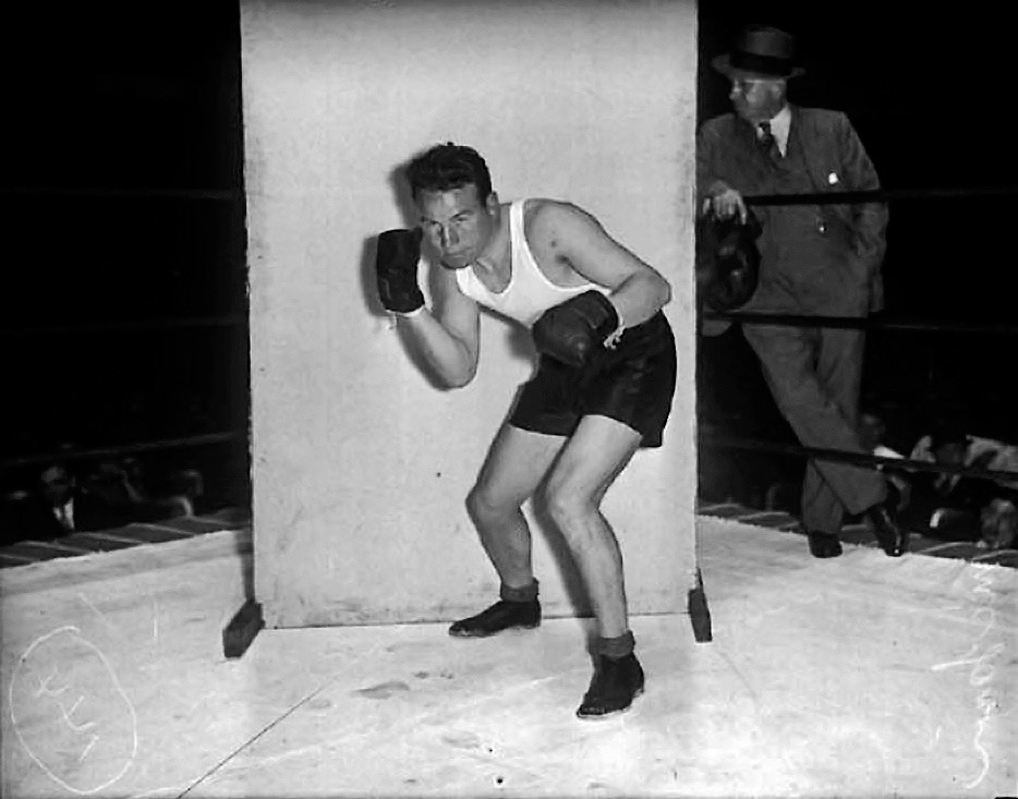 "Champion of the World, 1933 - 1935 Jimmy McLarnin was born in Ireland, but raised at 662 Union Street in Vancouver's East End. ""Our street was Union Street, not far from the docks,"" he told Maclean's Magazine in 1950. ""Some people would call it a poor street, and some people would call it a tough street, but to me it was a good street because there was always something going on."" When he was 13, a former professional boxer in the neighbourhood named Pop Foster witnessed McLarnin get into fisticuffs with another boy and recognized his talent. Foster approached Jimmy's father and promised to make him a champion. ""A champion of what?"" Sam McLarnin queried. ""A champion of the world."" Fourteen years later, Jimmy ""Baby Face"" McLarnin knocked out Young Corbett III just 2 minutes 37 seconds into the match, making him the Welterweight Champion of the World. He lost and regained the title the following year, and lost it for good in 1935. He retired in 1936 with a career record of 63 wins, 11 losses, and three draws.   Winning the title made McLarnin an instant celebrity, allowing him to hobknob with the rich and famous (he once declined Mae West's advances because his heart belonged to a school teacher back in Vancouver). But nowhere was his popularity greater than in his home town. Boxing became the unofficial sport of working class Vancouver boys and makeshift rings sprouted up in backyards throughout the city. Jimmy McLarnin died in 2004 at the age of 96. Source: Tom Hawthorn's Blog"