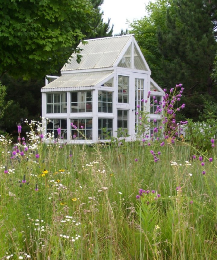 bitchinsitchin:  Greenhouse made from recycled windows by Jan and Ed Vitse of New Look Floral (a garden and floral business) in Rochester, Mn.. This little gem, made from recycled windows was built in 2003. The structure is 12 feet long by 6 1/2 wide, and 10 1/2 feet tall. (via Greenhouses from Old Windows and Doors)