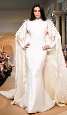 Pictured above: Fan BingBing for Stephane Rolland Haute Couture Fall 2012 STEPHANE ROLLAND HAUTE COUTURE, FALL 2012Paris, July 3rd It goes without saying that Stephane Rolland is one of the kings of haute couture. Time after time, Rolland presents collections that can only be described as fabulous and stunning. Two words that I don't use often. Stephane Rolland's collections are popular and celebrities rely on him to produce garments that will out-stage their fellow celebrity friends. Previous wearers of his designs include Lady Gaga who is  known for her outrageous and stunning clothes, Cheryl Cole, and most recently, Beyonce Knowles, who wore a chartreuse one-sleevegown with a hip-high slit from the Spring/Summer 2012 collection at the BET Awards. With that in mind, it's no surprise Stephane Rolland kept with a very similar theme for Fall/Winter 2012. There was the usual long crepe de chine and stain evening dresses all with the heavy draping and long trains, silhouettes that reveal every curve, and plenty of ostrich feather embellishments to add a whole new level of sophistication. The only difference with this offering was the palette. Last season Rolland played with bright reds and absinthe-green. This time, Rolland took note of the season and used autumnal shades and plenty of snowy white. Metallic gold also took a back-seat this season after being incorporated onto almost every garment last season. Stephane Rolland may have took repetition to a whole new level, but I'm not fussed. The collection will be popular, perhaps not so much as last season, but I won't be surprised if I see A-list celebrities lavished in Rolland's elegant and sophisticated designs.   Photo: © NowFashion