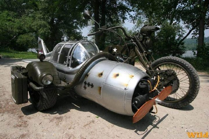 carczar:  Anyone want to do this to a Royal Enfield?  I think this would be great if it could be driven from inside the cockpit of the fuselage with no rider on the motorcycle.