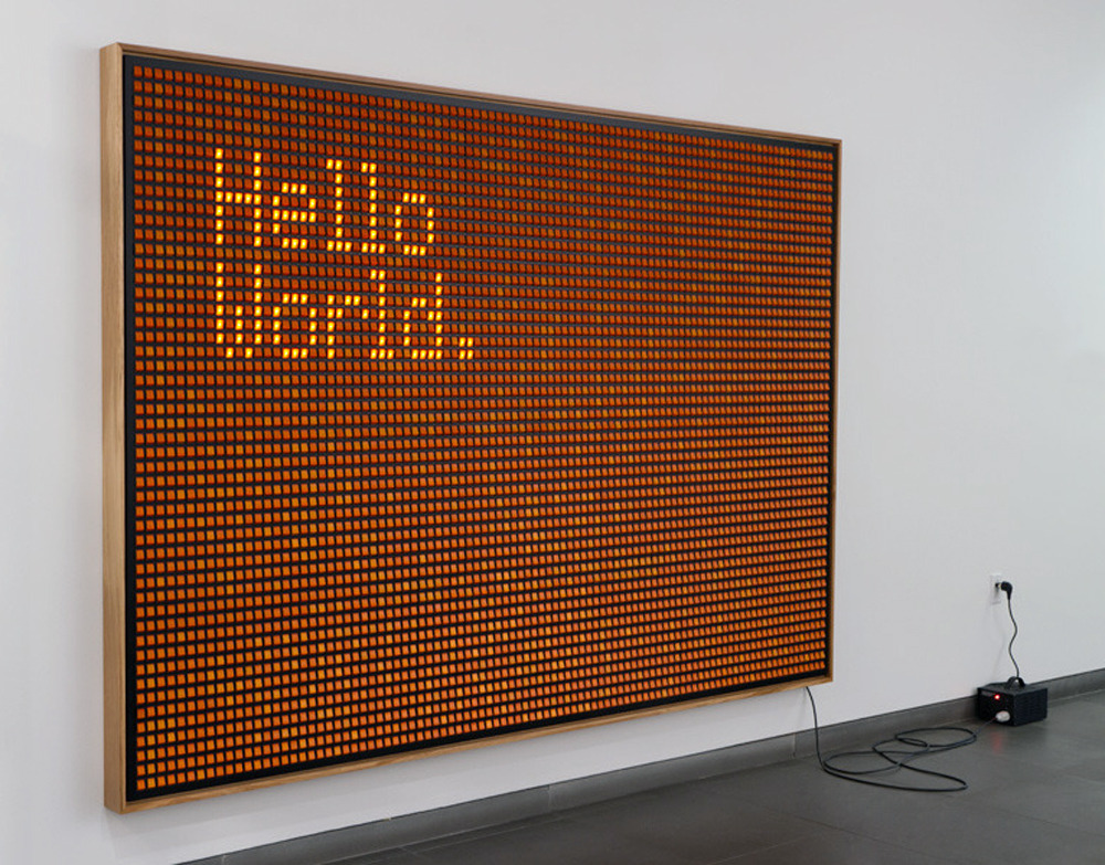 "instantjoy:  Valentin Ruhry - Hello World, 2011 ""A huge board of 5,000 rocker switches, the message is a nod to the 'Hello World' computer program, one of the earliest programs in computer history which was set up for beginners learning computer programming."""