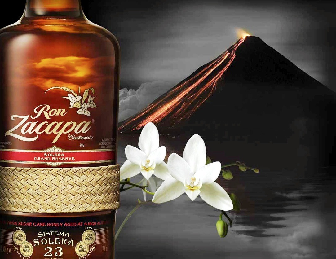 "Ron Zacapa is one of my favourite brands in the rum category. Not only because of its great flavour and unique mix-ability characteristics, but also because of its fascinating heritage and lengthy production process. But first, let us take a step back and look at the actual ""Rum"" category and then finish with the Zacapa legend. After the invention of the distillation process in the 8th century, the rum category was initially harvested and produced in India until the Arabs took the process to Spain. It was then during Spanish colonization that the process of making rum arrived in America. The original process of making rum was crude and very inconsistent, which often lead to the category only being consumed by the lower class. The sugar cane needed to make rum grows extremely well in tropical climates, which was another reason for the category doing extremely well in the Caribbean. History of Ron Zacapa Centenario The Ingenio Tululá sugar processing plant was founded in 1904 at Retalhuleu on the Pacific coastal plain of Guatemala. Since this time it has produced raw, direct white sugar and ultimately molasses. At the beginning of the 20th century the Botran and Requejo families were living in the Burgos province. The children of the two families married and produced five sons, and moved to Quetzaltenango where they subsequently founded Industria Licorera Quezalteca in 1950. Also in the early 20th century, several other Guatemalan families founded their own companies and independent distilleries in different regions of the country: Industria Licorera Guatemalteca (1937), Industria Licorera Euzkadi (1930), Licorera Zacapaneca ""Zacapa Distillery"" (1940). Licorera Zacapaneca was based in the province of Zacapa and was founded by three Guatemalan families named Girón, Estrada and Gordillo. Upon opening their Licorera they hired as the Master Blender a Spanish rum expert, Dr. Alejandro Burgaleta, who developed a very special rum to be made with virgin sugar cane honey, Ron Zacapa. In 1960 Distribuidora de Licores La Nacional was created to unify the marketing, distribution, and sales of ILG, as a result of which there were dramatic improvements in both plant technology and a huge step up in the quality of the rums being produced. The most important technological changes included the introduction of more productive cane varieties that matured earlier; new methods of cultivation, fertilization, and pest control; a new type of machete; technical organization of labor; mechanization of loading; the introduction of new centrifuges; and other procedures to improve productivity in extracting sucrose in the factory. In some mills, cane-cutting machines were introduced, but in general mechanization has not taken over given its high cost, the special conditions necessary for the equipment to function, and the abundance of cheap labour. At the same time, administrative modernization was also introduced, based on management methods inspired by a vision of quality control, computerized information, and annual evaluations of the harvest in the company and industry. Guatemala is now the 5th largest exporter of sugar in the world and the 2nd most efficient producer. As the world price of sugar rose in the 1960's, Guatemala's sugar factories were upgraded and new state of the art factories and distilleries were built by the company. The current maturation facility at Quetzaltenango opened its doors in 1968 and was built on land 1.5 miles (2330m) above sea level, the highest such facility in the world. Production Zacapa Centenario rum is painstakingly crafted through a sublime harmony of place and time. It is the specific combination of soil, climate, and altitude that make up the terroir of Guatemala, together with the unusual degree of control, that enables the devotion and passion of Lorena Vásquez, the Master Blender, to create what is widely acknowledged to be the world's best tasting rum.  The production process is a wholly owned, vertically integrated process with exemplary quality control at all levels. The story begins with sugar cane grown in the company's own plantations. The soil here is a fertile clay-rich volcanic type only found in Guatemala, which gives a specific flavour to the rum. The cane juice is pressed, filtered, and heated to removes water and impurities, but retain the sugar, leaving a virgin cane honey with a delectable sweet taste and the same balance of sugars as the original cane.  For fermentation a specific single strain of yeast is used which has been chosen for its compatibility with the virgin honey. It allows for a long slow fermentation of around 120 hours during which the wealth of flavouring components which characterize the rum are created. The fermented mash is distilled in a copper-lined one-column still to an alcoholic strength of between 88 and 92% ABV. The use of the column still gives the Master Blender exemplary control over the distillation process and enables the retention of the flavouring congeners.  After distillation, Zacapa goes on an amazing journey from the Guatemalan lowlands to the highest ageing facility in the world at 2300m above sea level. The rarefied atmosphere at the 'House Above the Clouds' provides the perfect cool climate for the slow aging of rum. Using a dynamic Solera System, barrels of rum of the same type but different age are stacked on top of each other, the oldest on the bottom and the youngest on the top, which creates a system for combining blending and ageing. Different types of barrel that once held robust bourbons, delicate Sherries, and lush pedro Ximenez wines are used at different points in the solera. Each one imparts a specific character to the rum.  The blending of the rums is an art that is only possible to master after many years of experience. The purpose of blending is to allow for the strengths of the rums to stand out while making their character consistent and harmonious over time. Lorena Vásquez, the Master Blender, believes very firmly that each barrel is a living, breathing entity and should not simply be forgotten to gather dust in the warehouse. This is why she devotes her heart and soul to nurturing them, almost as if they were children. Guatemala was the cradle of the great Mayan civilization that dominated Central America for centuries and Mayan traditions still run deep. Zacapa is proud to represent one of them on its bottle: the band of petate. Petate is an artisanal matting hand-woven from the dried leaves of the palm. In the Mayan worldview it symbolizes the unity of everything. Just as the leaves of the palm are interwoven so are the earth and the sky, the sun and moon, and the physical and spiritual realms. This is why a woven petate band is placed around every bottle of Zacapa Centenario rum. It is a manifestation of the creativity and heritage behind the spirit, a liquid that is intimately bound up with the place and time from which it comes.  Zacapa 15 is a blend of rums aged between 5 and 15 years in the Solera System. It is soft and generous with notes of creamy vanilla, light orange, and elegant dried tropical fruits. Zacapa 23 is a blend of rums aged between 6 and 23 years in the Solera System. It is wonderfully intricate with honeyed butterscotch, spiced oak and raisin fruit, showcasing the complexity of the solera ageing process. Zacapa XO is a blend of rums aged between 6 and 25 years in the Solera System. It is perfectly balanced combination of sweetness, spice, fruit and spirit, a connoisseur's delight and the ultimate expression of the Master blender's art."