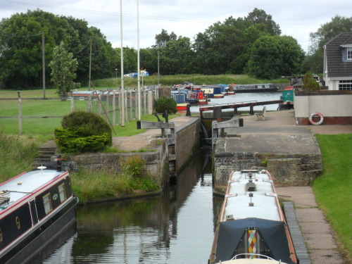 Hatherton Junction on the Staffordshire and Worcester canal, now a marina and canal boat storage the canal used to go on past the locks in the top Right Hand corner. But in 1955 due to mining subsidence it was abandoned and is now over grown, it's a secure storage and you can't access the area. I'd like to try and trace the route of the old canal, perhaps from the other direction and on foot.