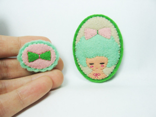 A girl with extra ribbon felt pins (by hanaletters) Gorgeous pins from Hanaletters flickr.  So many beautiful felt based pins on this flickr. Go check it out!
