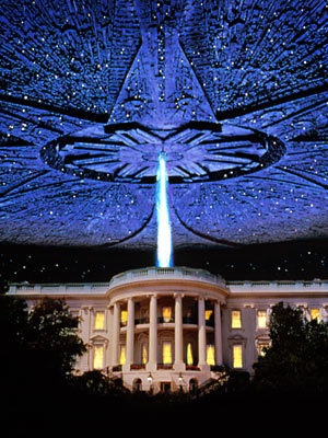 "Film Review- Independence Day (1996) Now I've already done a small of review of this but I wanted to do a more detailed review in the ultimate Summer blockbuster that is the most patriotic film ever to be made but is really a true architect of a great Summer Blockbusters. Plot- Aliens from a mysterious planet decides to invade Earth and kill everyone and steal all natural resources and move on to other planets. Just like locusts. In simple terms the film tracks America's attempt to stop them. There is intertwining stories that create the jigsaw of this film. There's the smart nerd (Jeff Goldblum) who has just divorced his ex wife who works for the president.  The story of the president (Bill Pullman) who is being challenged by critics of being weak. The fighter pilot (Will Smith) whose fiance is a stripper and wants to be an astronaut. And the redneck who is an alcoholic and is crazy because he was abducted by aliens. The intertwining stories of love, passion and hope all fit into place creating a fine summer blockbuster about aliens. Review- Critics everywhere calling this a dumb movie, a sell out and just a brainless movie for zombified audiences. Well it's isn't the most intelligent film in the world. It's no complex thriller like Memento or classic like the Godfather but why should we stigma Independence Day for being a a summer blockbuster where Jaws is heralded as a classic. There is cliche's here with alien invasions and a cheesy script. However I judge films of how much I enjoy them and this is a film that I watch one day every year, on the 4th of July and I enjoy it every time. It's exactly what you want for a summer blockbuster and gives that little more. It has explosions, most notably the White House exploding. Great special effects which hasn't outdated at all. Even though it came out 16 years ago. It has a simple plot which is easy to follow, it's funny, loud and overall a good popcorn movie. It's not trying to be a oscar winning film with complex themes, it's trying to be a film that ""appeases the masses"", a film that is enjoyable for all the family and still to this day can be enjoyed. The cast is also magnificent and brings the film to life even with a clunky script. The film that made Will Smith a Star because it demonstrates his likability, his charming persona and he is a funny guy. I'm a big fan of Jeff Goldblum, he can play the geeky character with a weak physique but still be stronger then most of the cast in stature. I like to see non typical action stars be a lead action star. Viva La Goldblum!! Also Bill Murray plays the archetype president with great substance. The president speech in this film is the most inspiring, patriotic speech to ever grace cinema. It just beats William Wallace Freedom speech to clinch the top spot. Randy Quaid plays the wacky redneck father with hilarity and it's a shame his personal life has been strewn with addiction and jail because every film I see him in, he doesn't disappoint. The rest of the cast is just as great and plays their role so well. Cliched as they maybe, the cast do there best to escape the cliche and just do it just because they are likable character that seem real, well the president is hard to believe, but it's Bill Pullman so I'm not going to argue. Independence day is a $75 million B- Movie, it's a throwback to the old sci fi films which were lagging at this point. It rejuvenated the summer blockbuster because of it's boldness and memorable moments. The ensemble cast, the different perspectives, the explosions, the end of the world situation. Those films have been common in recent times. The film has special effects that eclipse most films today, even though it's 16 years old, nearly as old as me! The white house explosion is still a scene to marvel at. There are epic moments in Independence Day, funny moments, explosions and cool aliens. What more do you want for a film?! A true summer blockbuster that isn't a dumb movie! It's a brilliant throwback to sci fi films of the 1950's, has a hilarious and ""inspiring"" script that creates lovable characters. I find it annoying that people call this one of the most dumbest movies of all time when there are films like Transformers and Battleship that doesn't give two monkeys about characters. It's all about the explosion for them. Also with the huge influx in remakes and sequels this film needs to have more credit, because Independence Day brings ideas from old movies and creates a new, fresh movie that is brilliant and enjoyable to watch. Overall- A amazing summer blockbuster, it isn't the smartest film but it isn't the dumbest. It's a blockbuster that still focuses on the characters but has great special effects, funny moments and brilliant looking aliens. It is a guilty pleasure that I watch every year. I'm not american but I love this film and I always find it enjoyable. It rejuvenated the summer blockbuster and even though the script isn't the greatest and it does hit some cliches, it's fin, loud and one of the greatest summer blockbusters out there that has a great and something that I haven't seen replicated since. A really brilliant popcorn movie for everyone. I don't care about the haters. Film Rating 8.5/10"