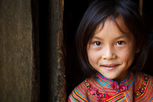 v-agabonds:  Portrait of a Flower H'mong hill tribe girl wearing traditionally colourful clothing, in a small village near to Cao Son market. (by © Coole Photography)