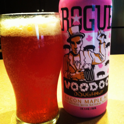 "Voodoo Donut Maple Bacon Ale from Rouge. I have been eyeing this one for a few weeks and have had a few people tell me it's ""delicious"", ""taste's like breakfast"" and ""awesome""….. It was really smokey and lacked maple for me. It was fun, kinda like watching bad reality TV, you did it, now you can talk about it but what did you actually get from it? Maybe It was talked up too much but I'd rather pick up something else from Rouge's extensive selection."