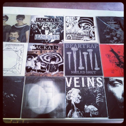 "vrevolutionyeah:  New records in! (Taken with Instagram)  Two Moshtache releases here Jackals/ Grazes split and the BearTrap 7"" that I've not had in stock for over 6 months- grab it!"