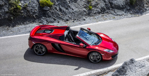 McLaren MP4-12C Spider revealed After speculation last week, we can confirm that the next chapter in the What Car Will McLaren Make Next? saga is one hundred percent the McLaren MP4-12C Spider. And look at it, it's stunning. And to answer your question - yes. It's got the more powerful 616bhp, 3.8-litre twin-turbo V8. And yes, it'll do over 200mph - but only 204mph, 3mph slower than it's closed-roof sibling. Even so, hairpiece owner will need some stickier glue as the Spider does 0-60mph in 3.1 seconds - the same time as the coupe. The Spider uses a variation of the coupe's carbon-fibre MonoCell chassis. This 75kg tub requires no additional strengthening for it to feature in the 12C Spider and because of its F1 techyness, it means that the car is almost identical to its fixed roof counterpart in the performance department. Did we mention that it's stunning? Read the rest at TopGear.com