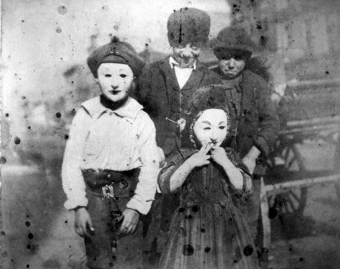 Children wearing masks in the Maxwell St. area, 1903, Chicago. UIC Digital Collections