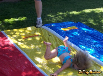 Girl Faceplants on Slip n Slide Oh, it says here that this isn't a Slip N Slide, it's a Fall N' Smash. That must be the problem.