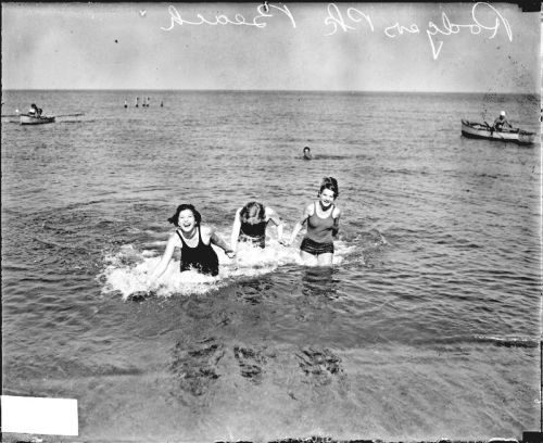 Three young women wearing bathing suits and holding hands at Rogers Park bathing beach in Chicago c. 1929. Photograph from the Chicago Daily News.  Want a copy of this photo?  > Visit our Rights and Reproductions Department and give them this number: DN-0088339 Connect with the Museum
