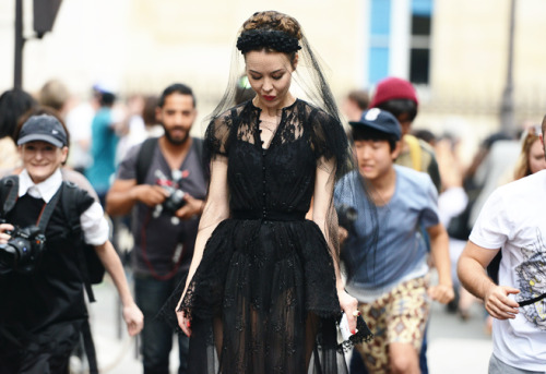 Ulyana Sergeenko wearing one of his own Couture dress. PFW street style.