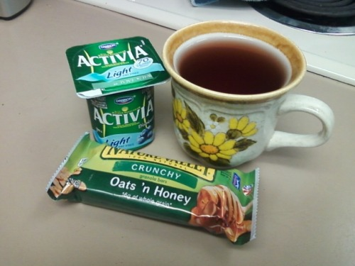 Blueberry Activia Light yogurt, a Nature Valley oats'n honey granola bar, and a cup of cherry Juicy Juice! 260 calories, not including the juice~