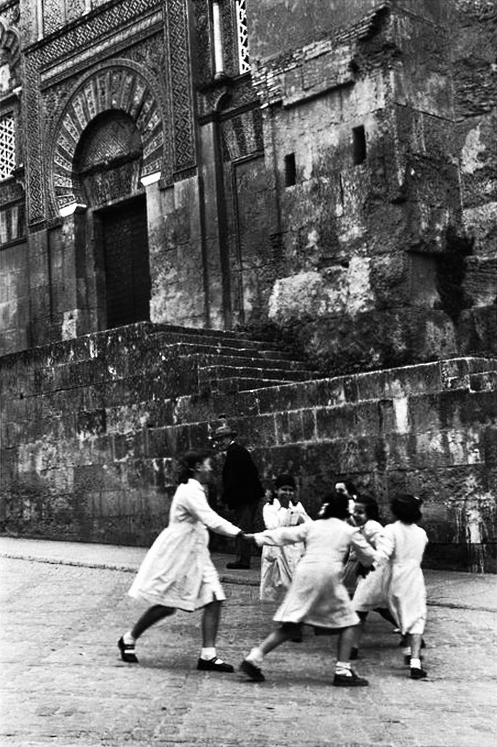 m3zzaluna:  schoolgirls dance in front of the mosque, cordoba, spain , 1954 photo by inge morath/magnum photos/the inge morath foundation