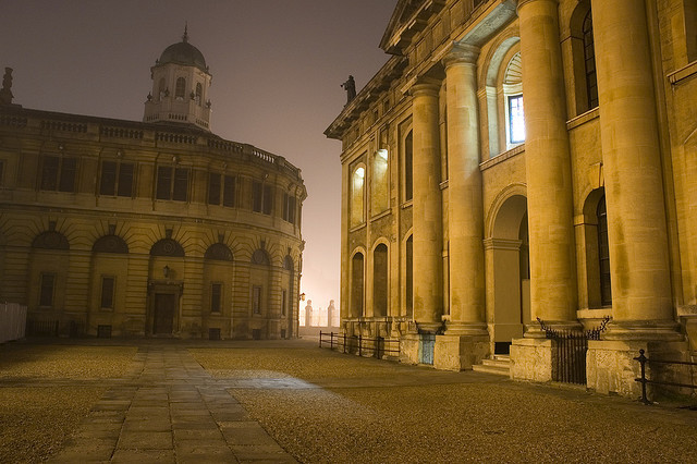 beautifuloxford:  Old Oxford on a Wintry evening by RichardLowkes on Flickr. Sheldonian Theatre and Clarendon building.   (I've performed here!)