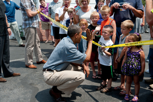 Scenes from President Obama's bus tour: High fives in Oak Harbor, Ohio.