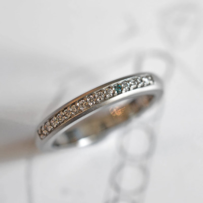 bespoke diamond stacking ring with one blue diamond