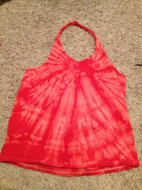 100 Ways to Transform a T-shirt: (17) I love this halter I made over the weekend, its super comfy and I can't wait to wear it to the beach. It's pretty simple to make, and it's perfect for shirts with large designs on the front that you don't particularly care for. So I started with this shirt:  What you want to do is cut off the sleeves and then cut the shoulders open, so you can lay it out like this:  Then cut as shown:  Granted, you can adjust how wide the neck line will be and how thick your straps are, but these are the general curves you will need to follow- also, note that you will technically be wearing it backwards from its original purpose. Just wanted to make sure that was clear. But after that, all you have to do is sew or even just tie up the straps, and you're good to go! Fair warning though- depending on the size of the shirt you make this from, it can be very very loose down the back. I recommend trying this trick to tighten it up just a bit, plus it looks rather cute :)