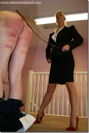 Mistress Nikki believes in motivating her staff by using corporal punishment and particularly the cane to encourage great productivity. Henry has been slacking off lately and letting the team down and so he is called to Mistress Nikki's office for a 'chat'. Web site: mistresswhiplash.com