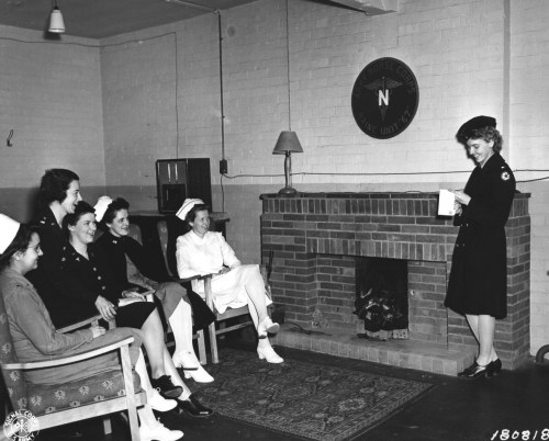 Nurses from Maine listen to a letter from home in the 67th General Hospital, Taunton, England, March 3rd, 1943