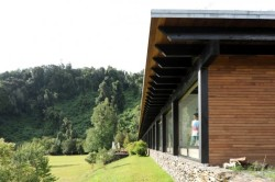 How about this house at Lake Rupanco in Chile? Very stylish and very in keeping with its environment. Source: http://www.archdaily.com/251322/house-at-lake-rupanco-izquierdo-lehmann/