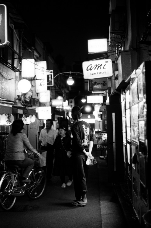 Golden Gai, Tokyo love those geta! Shot with Minolta X-7A & Kodak Tri-X 400 Check out my blog for more photos!