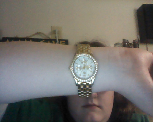ahh does this look like too mannish of a watch? my dad found it and it's defs a guy's watch but i like it and want to keep it but not if it makes me seem guyish????