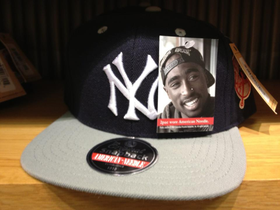 jadorefashionblog:  voguedissent:  WTF?  Tupac was born in New York and was raised in Baltimore. He moved to California, the West Coast when he was 16 so him being on this hat is apt.
