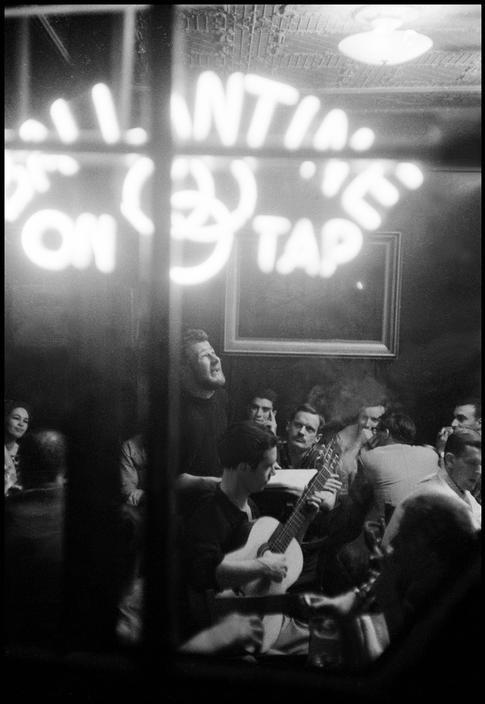 "bygoneamericana:  Poetry and folk singing at McSorley's Saloon. New York, 1959. By Burt Glinn  Let's all sing. A couple hours late for a ""Happy St. Patrick's Day!"" but this is how we'd spend a day claimed for drinking too much and general foolishness."