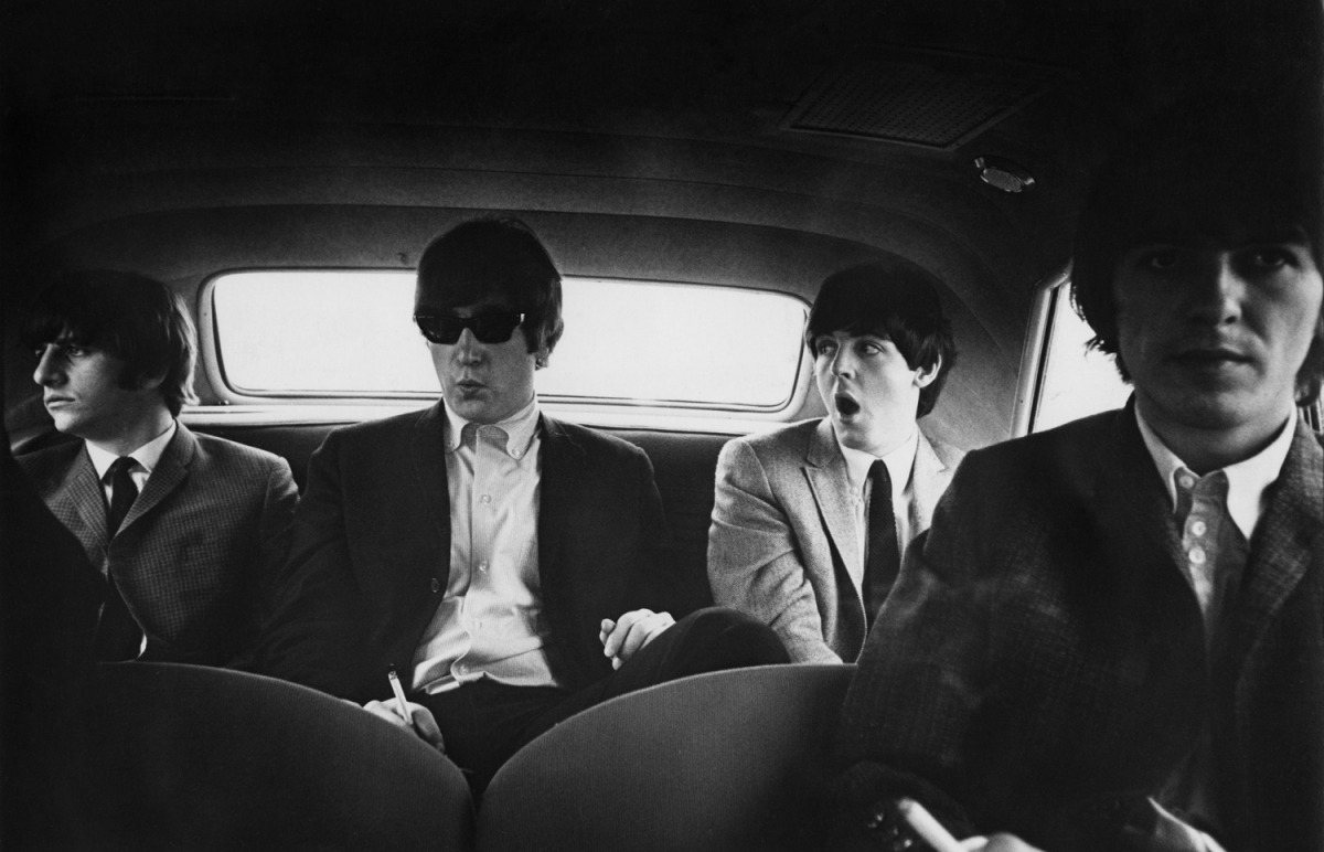 The Beatles inside a car in Denver, Colorado, 1964. By Curt Gunther
