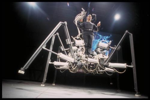 "Stelarc's piece ""Exoskeleton"" featured a ""six-legged, pneumatically powered walking machine."""