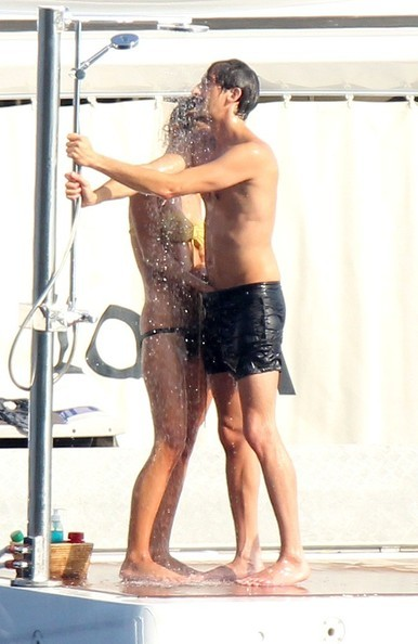 Adrien Brody gets a hand job from his girlfriend while taking a very public shower. she also sticks her finger in his ass :) very nice lol  Adrien Brody and his girlfriend Lara Lieto can't keep their hands off of each other as they vacation aboard a yacht in the South of France with friends. The couple chase one another on the deck of the boat before going for a swim. Brody shows off his diving skills, and then swims back to the ship to get a very hands on massage from his bikini clad girlfriend as they shower the seawater off together.