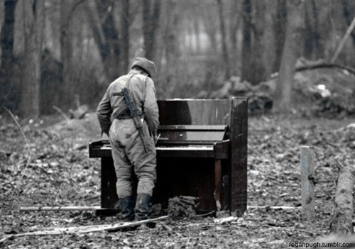 reganpugh:  Russian soldier playing an abandoned piano, date unknown.