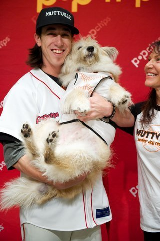 "BASEBALL PITCHER TIM LINCECUM HELPS SENIOR DOG GET ADOPTED - ""Tim is a huge animal lover…He thought about becoming a zoologist, but he decided he would play baseball instead."" San Francisco Giants pitcher Tim Lincecum has teamed up with a rescue organization called Muttville Senior Dog Rescue to promote the adoption of older dogs.  Recently, a dog named Timmy accompanied Lincecum to the baseball field to spread the word about senior dogs.  Thanks to this event, Timmy will soon be adopted into a permanent home.  Here's more from the SF Weekly:  You might have watched the game last week when Lincecum appeared on field before the first-pitch against the Cincinnati Reds, with Timmy — an elderly mixed terrier, in tow. This was Lincecum's way of drawing attention away from his bad pitching streak and toward this 11-year-old pup whoreallyneeds a home.  And it worked!   ""He's definitely on his road to adoption,"" says Sherri Franklin, the executive director of Muttsville Senior Dog Rescue, the nonprofit that houses Timmy, and 70 other senior citizen dogs. Timmy currently has three potential parents who are interested in taking him home after spotting him on the mound at AT&T Park.   Older dogs typically have a harder time being adopted, so it's great to see stories like this.  It appears that Timmy will spend the rest of his years with a loving family.  Click here for the full story, and here to learn more about Muttsville Senior Dog Rescue."