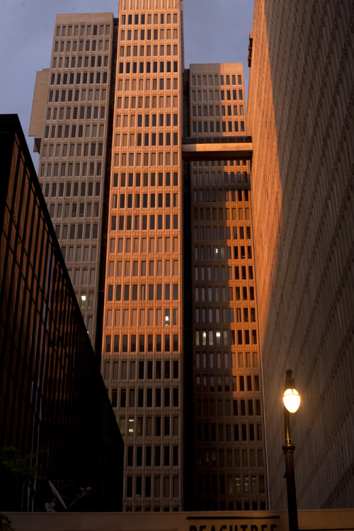 Nice photo of the Peachtree Center towers at sunset  Untitled, 2012  What a great photo from blogger alexxphoto. Sunset on a clear day — it's one of the best times to enjoy the tall buildings of downtown Atlanta. There's a particularly striking transformation with these Peachtree Center towers, built in the late 1960's and designed by John Portman. Fairly bland and, frankly, dismal looking the rest of the day, they are blessed with a brief prettiness as the golden glow of the setting sun creates warm hues and interesting shadows. If you're thinking of taking a stroll downtown to enjoy the impressive range of architectural styles here, I recommend sunset.