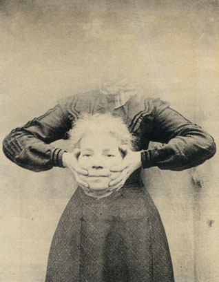 "A photograph of a ""headless woman"" produced around 1900."
