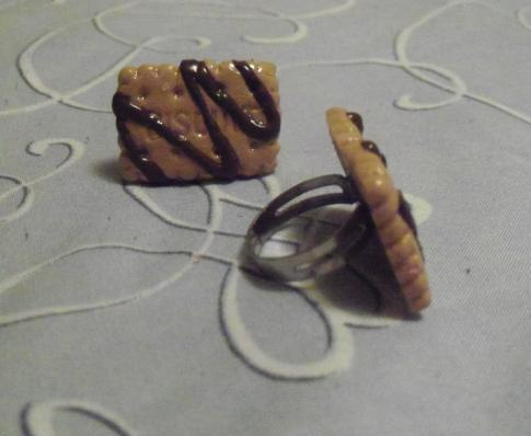 Chocolate covered biscuit rings. Rings are adjustable.  Asking: $5 each. Stock: 3. Message me if interested.