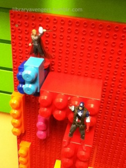Thor and Captain America clean up the Lego in the Discovery Center.