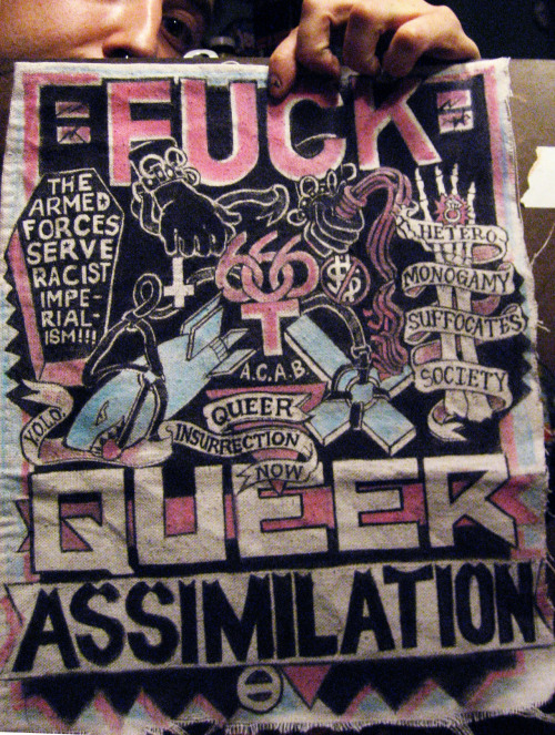 "riley-ferretboy-konor:  imfuckingdead:  ""FUCK QUEER ASSIMILATION The Armed Forces serve racist imperialism!!!  Hetero-monogamy suffocates society Queer insurrection now Y.O.L.O.//A.C.A.B"" …Drew up this back patch for Wombat!! <3 <3 <3  ^ The handsome fellow responsible for the creation of this (AMAZING) patch is making me a large back patch for my vest I am working on. The concept art we have been discussing for it is ridiculously awesome, so I cannot wait to get it and show it off to you folks."